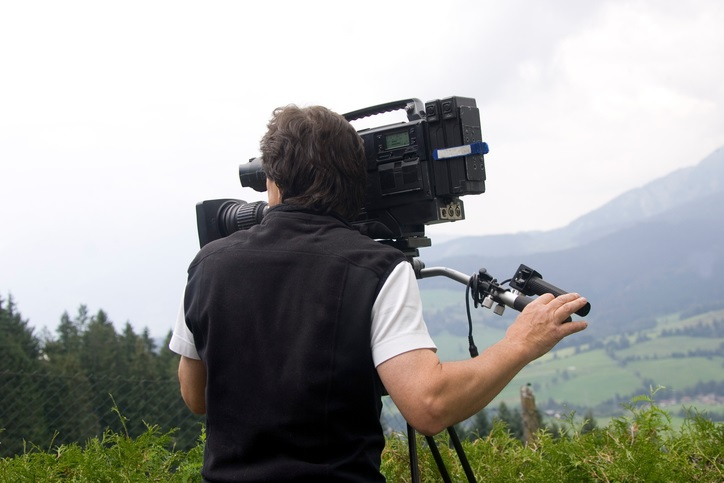 Cameraman in Mountains
